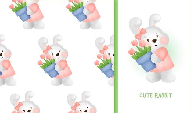 Modèle sans couture avec lapin mignon tenant une carotte.