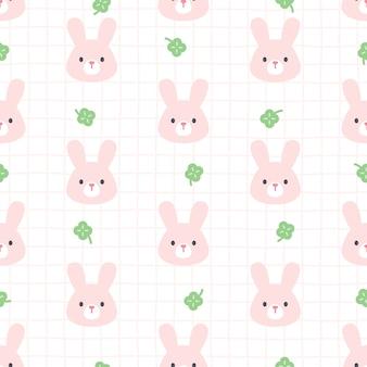 Modèle sans couture de lapin et trèfle feuille chanceux