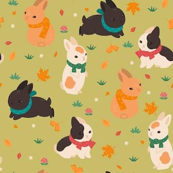 Modèle sans couture avec des lapins en écharpes. graphiques vectoriels.