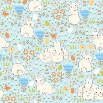 Modèle sans couture avec des lapins et des œufs.