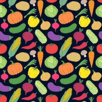 Modèle sans couture avec des légumes dessinés à la main sur fond noir