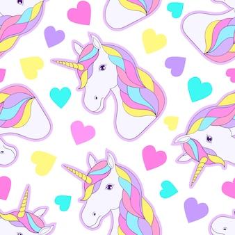 Modèle sans couture avec des licornes colorées et des coeurs