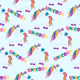 Modèle sans couture avec des licornes de dessin animé, fond blanc avec lettrage pour papier peint. texture de cheval mignon illustration vectorielle, interface de conception.