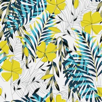 Modèle sans couture lumineux tropical avec des plantes et des feuilles colorées