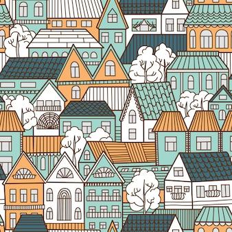 Modèle sans couture avec des maisons et des arbres.