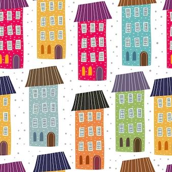 Modèle sans couture avec maisons de dessin animé