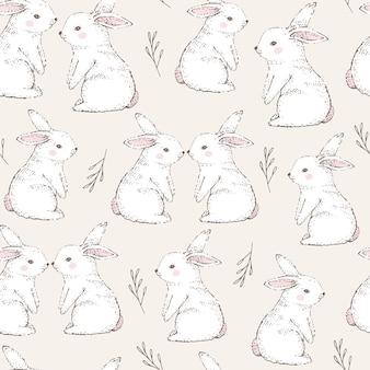 Modèle sans couture avec mignons lapins blancs.