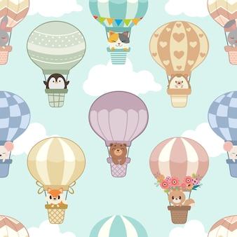 Modèle sans couture de montgolfière avec des animaux sur le ciel et les nuages.