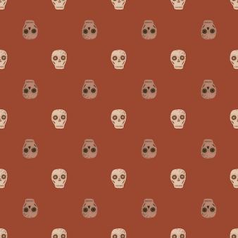 Modèle sans couture de mort avec des éléments de crâne de couleur beige.