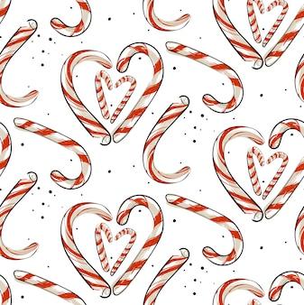 Modèle sans couture de noël abstrait dessiné main avec des cannes de bonbon