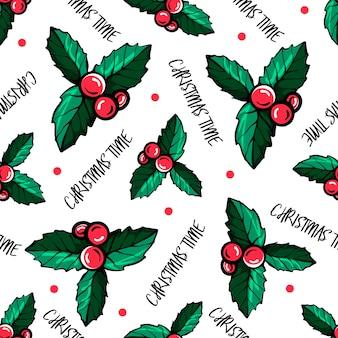 Modèle sans couture de noël aux baies rouges. les baies de holly.christmas pattern. illustration vectorielle dessinés à la main