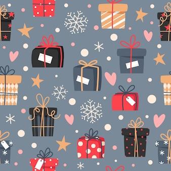 Modèle sans couture de noël avec des cadeaux et des flocons de neige