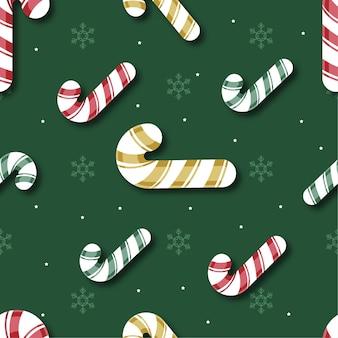 Modèle sans couture de noël avec canne en bonbon et flocon de neige