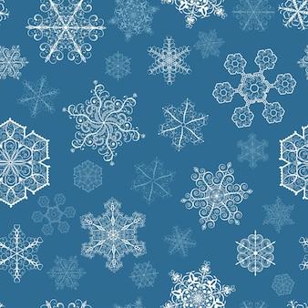 Modèle sans couture de noël avec de grands et petits flocons de neige blancs sur fond bleu foncé