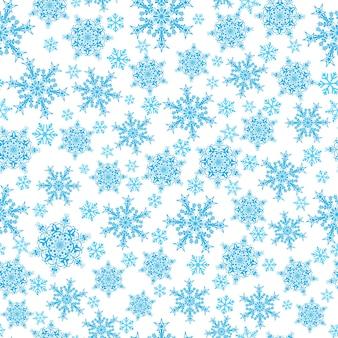 Modèle sans couture de noël de grands et petits flocons de neige, bleu sur blanc