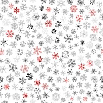 Modèle sans couture de noël de petits flocons de neige, rouges et gris sur blanc