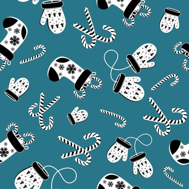 Modèle sans couture noir et blanc de moufle en laine bleu et chaussettes de noël