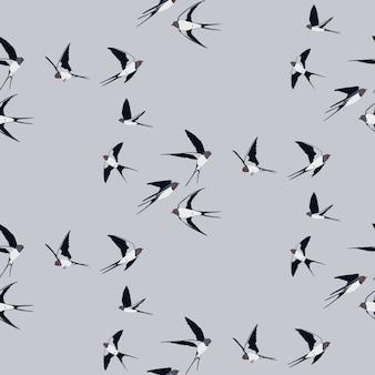Modèle sans couture avec des oiseaux hirondelles