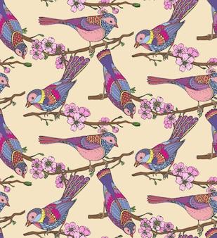 Modèle sans couture avec oiseaux ornés dessinés à la main sur fleur de sakura