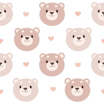 Modèle sans couture d'ours et de coeur sur fond blanc.