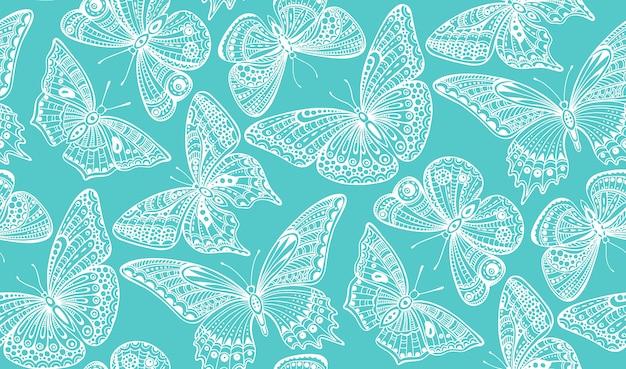 Modèle sans couture avec papillons dessinés à la main doodle orné.