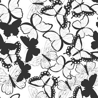 Modèle sans couture avec papillons silhouette dessinés à la main, noir et blanc