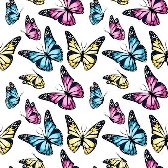 Modèle sans couture de papillons volants colorés lumineux