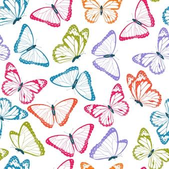 Modèle sans couture de papillons volants de couleur. isolé sur fond blanc.