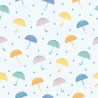 Modèle sans couture de parapluies de couleur de vecteur. fond de dessin animé mignon