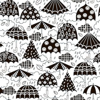 Modèle sans couture avec des parapluies noirs et blancs