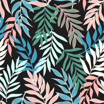 Modèle sans couture avec des plantes et des feuilles sur un fond sombre