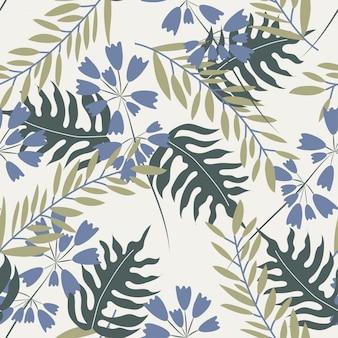 Modèle sans couture avec des plantes tropicales et des fleurs