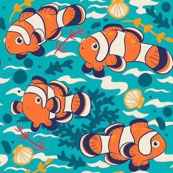 Modèle sans couture avec poisson clown mignon.