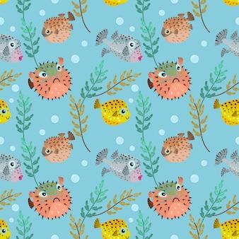 Modèle sans couture de poissons puffer dessin animé mignon.