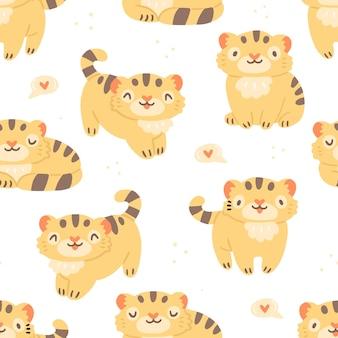 Modèle sans couture pour enfants avec de mignons petits tigres et coeurs sur fond blanc