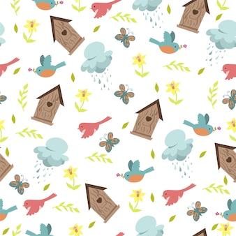 Modèle sans couture de printemps avec des oiseaux et des nichoirs sur fond blanc.