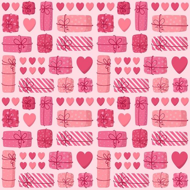 Modèle sans couture rose de coffrets cadeaux et de coeurs.