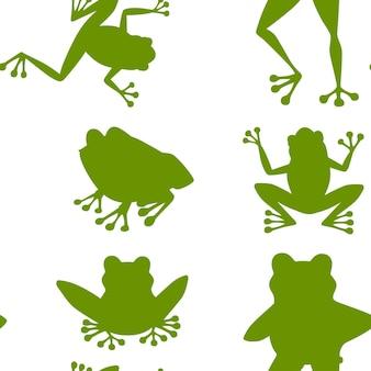 Modèle sans couture de silhouette verte de grenouille verte souriante mignonne assise sur le sol dessin animé animal design plat illustration vectorielle sur fond blanc.