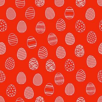 Modèle sans couture de silhouettes d'oeufs de pâques. fond d'emballage de vacances de pâques