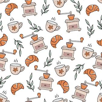 Modèle sans couture de style doodle dessiné main de croissants et tasses de café près de moulins et de feuilles vintage