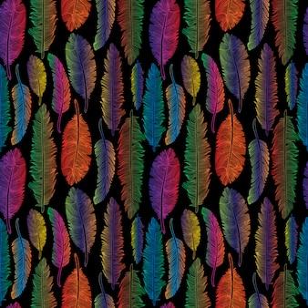 Modèle sans couture de style tribal de plumes arc-en-ciel sur fond noir.