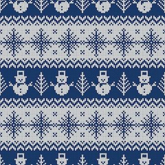 Modèle sans couture tricoté avec des bonhommes de neige et des flocons de neige.