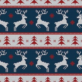 Modèle sans couture tricoté avec des cerfs et des sapins.
