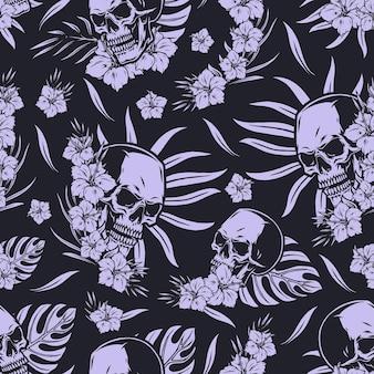 Modèle sans couture tropical vintage dans un style monochrome avec des fleurs et des feuilles exotiques de crânes