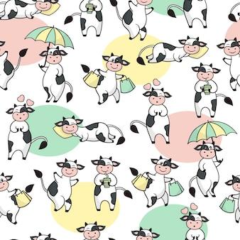 Modèle sans couture avec des vaches mignonnes de dessin animé drôle.