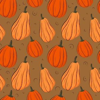 Modèle sans couture de vecteur automne dans des couleurs chaudes. citrouille et contours de feuilles tombées.