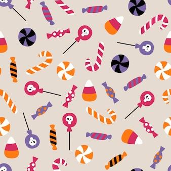 Modèle sans couture de vecteur halloween avec des bonbons modèle avec des bonbons pour l'illustration plate d'halloween