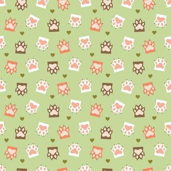Modèle sans couture vert avec des pattes de chat et des coeurs