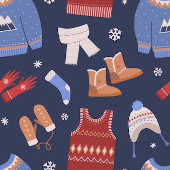 Modèle sans couture avec des vêtements d'hiver tricotés sur dark