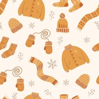 Modèle sans couture avec des vêtements d'hiver